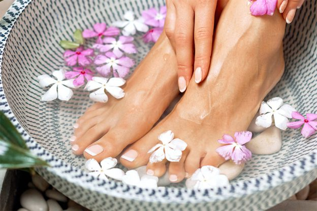 a young womans feet with flowers