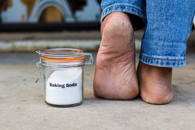 Baking soda can be used in a paste to remove foot calluses.